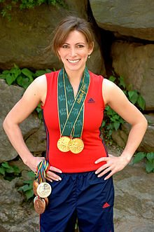 220px-Shannon_Miller_with_medals_in_gym_outfit